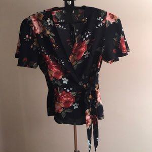 Navy floral wrap around peplum style blouse